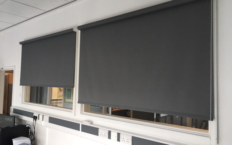 Grey pull down blinds